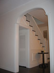 Arch leading to Stairwell and second floor