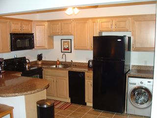 Weirs Beach condo photo - Fully Equipped Kitchen including an apartment size washer and dryer