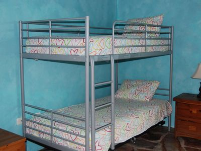 Middle bedroom with bunk beds.