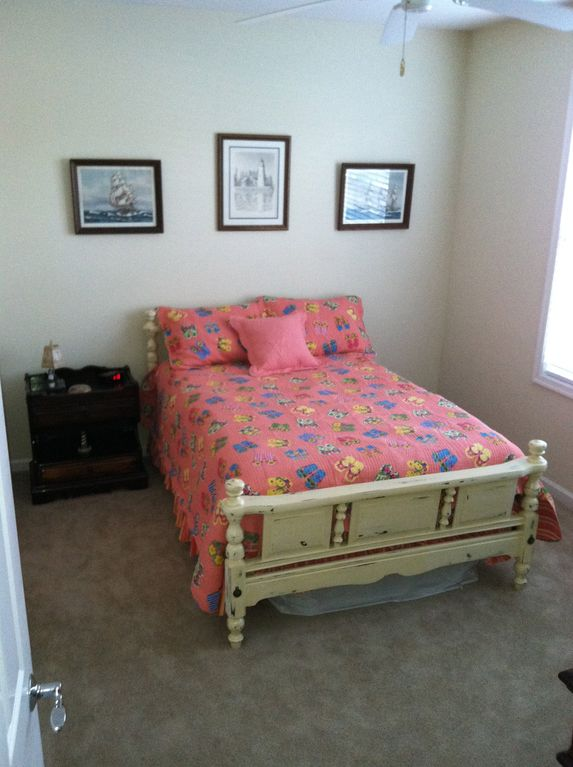 A nice and bright second bedroom with a full sized bed