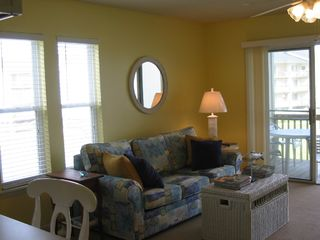 Surf City condo photo - Living room with queen size sleeper sofa opens to deck and views