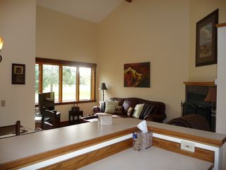 Columbia Falls condo photo - OPEN FLOOR PLAN~ Vaulted Ceilings, Nestled in pines w/Spacious windows/view.