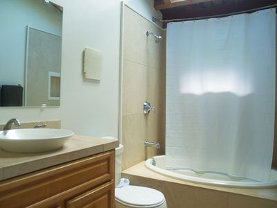 Remodeled upstairs bathroom with jacuzzi tub and shower