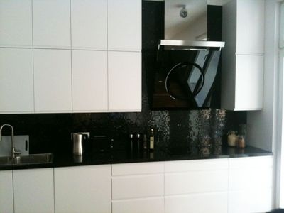 Kitchen with induction hub and marble mosaik