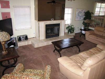 3 Bedroom: living room w/ fireplace, large flat panel LCD HDTV, stereo...