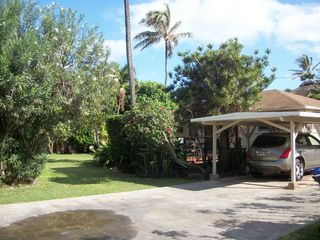Sunset Beach house photo - Tropical Garden Setting and large yard... plenty of room for kids to explore!