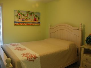 Garden City Beach house photo - Cool little room. Brand new memory foam mattress and wall mounted flat screen