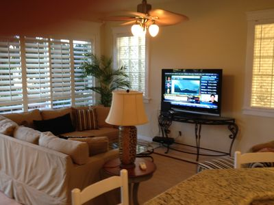 Comfortable TV/family room overlooking the first hole on the new Fazio course.