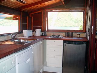 Fully equipped kitchenette, including dish washer. - Moorea bungalow vacation rental photo