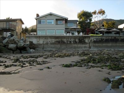 View of the house from the beach at low tide.