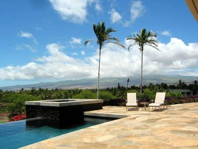 The Extensive Lanai - boasting two sunning decks, an infinity-edged pool & a spa