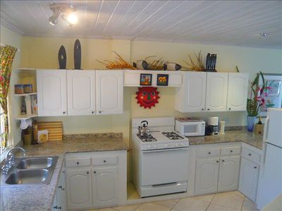 Modern, spacious fully equipped kitchen with granite counters & ceramic floor.