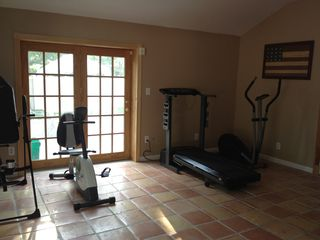 Hampton Bays house photo - Work-out with a weight bench, elliptical, treadmill, bike and Inversion table.