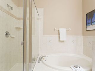 Ormond Beach condo photo - Luxury master bathroom has 2 vanities, tub and shower.