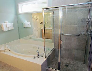 The attached bath has a new shower in addition to the jetted spa tub.