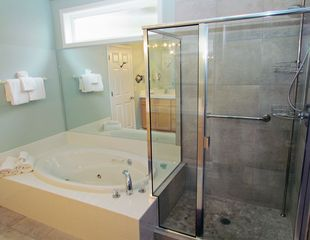 Depoe Bay condo photo - The attached bath has a new shower in addition to the jetted spa tub.