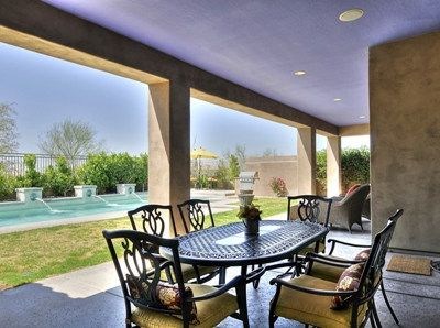 Covered patio with beautiful patio furnitures