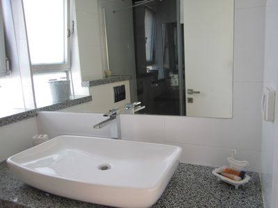 Upper floor bathroom with large shower