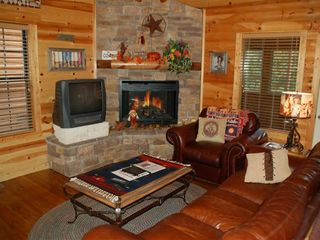 Branson cabin photo - Fireplace, games, dvd's, sleeper sofa.