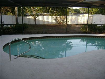 Private screened in solar heated pool
