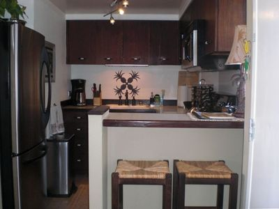 Fully appointed  kitchen includes refrigerator, dishwasher, microwave and stove.