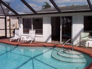 Fort Myers Beach house photo - Pool depth goes from approx 3 ft a the steps to approx 8ft at the far end