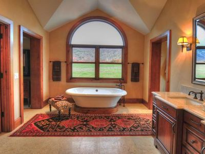 Master bathroom includes shower & bathtub with great views to mountains