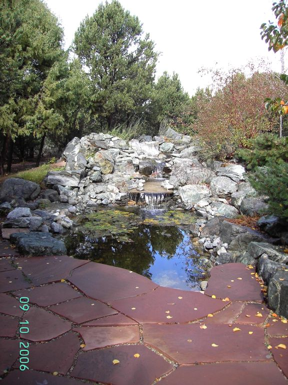 Rock waterfall with lily pond