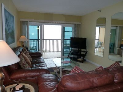 Leather furniture, HD flat screen TV and a direct view of the Gulf-life is good!