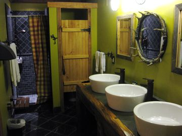 The 2 big bunk rooms share this huge bathroom with 3 sinks