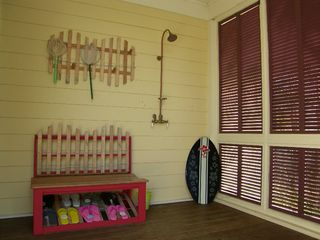 Port St. Joe house photo - Flip flops greet your arrival in the outdoor shower.