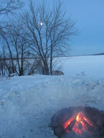 Warming up after ice fishing - Firepit sits right out front of cabin.