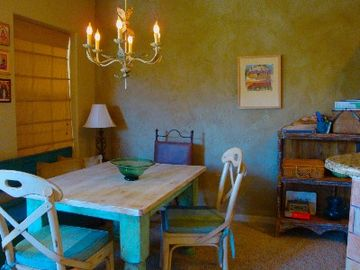 Large dining or work area; chandelier, local art, one of a kind furnishings