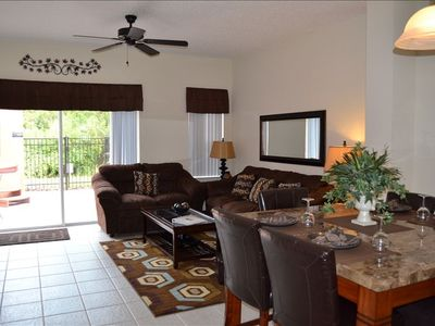 Living/Dining Room... Dining table sits 6 comfortably.  Steps to private patio.