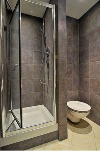 Main bathroom with bath tub and shower