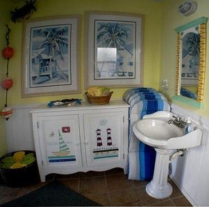 Guest bath with beach towels and cushions for the downstairs furniture,