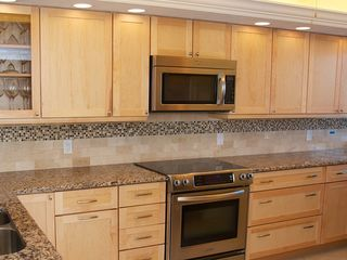 Redington Shores condo photo - New cabinets with pull out pantry. Stove with warming tray.
