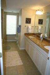 Kingston Plantation condo photo - Master bath with two sinks, shower and separate jetted tub.