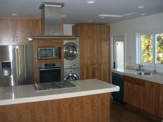 Silver Lake apartment photo - Gourmet kitchen- stainless appliances, cherry cabinets, quartz counters.
