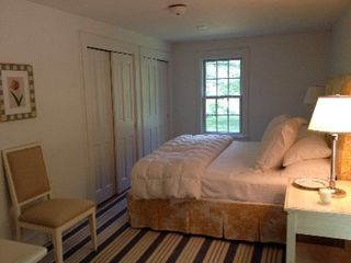 Woodstock farmhouse photo - Master Bedroom - king bed, first floor. Satelitte tv in built in closet.