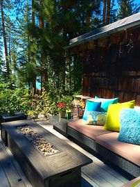 Lincoln Park cottage rental - Enjoy an afternoon on the front deck! Turn on the fire when the sunsets!