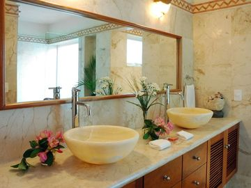 Master bathroom has his and her sinks, and large glassed in shower for 2