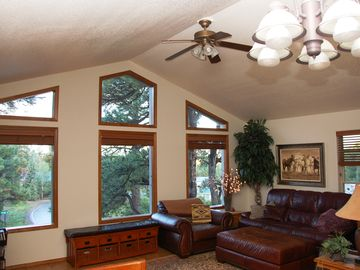 Pagosa Springs house rental - living room w/views of foothill sunsets; leather furniture; porch access