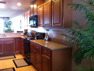 Beautiful wooden cabinets, granite countertops and hardwood floors!