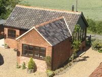 Luxury exclusive lodge in rural suffolk on SSSI with horses grazing nearby