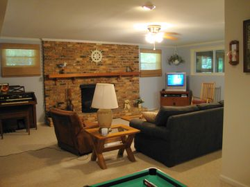Lower level fam rm, small game table, seats 6+, new flat screen TV (not pictured