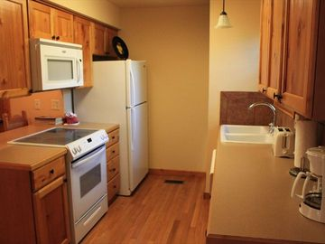 Kitchen comes fully equipped and window provides stunning lake view.