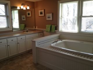 Middletown house photo - Master bath features whirlpool, two sinks, separate shower and water view.