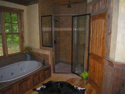 Main floor Master Bath w/ jetted tub and large tile shower all trim in barn wood