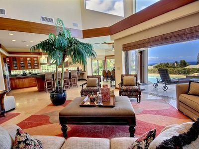 Open floor plan with plenty of windows creates a bright, tropical space.